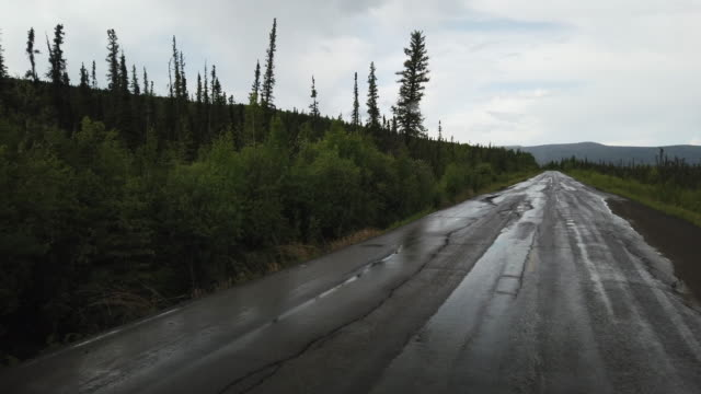 dashboard camera point of view of damaged alaska dalton highway - deterioration stock videos & royalty-free footage