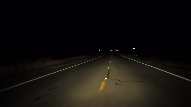 Dashboard camera point of view of driving at night in USA