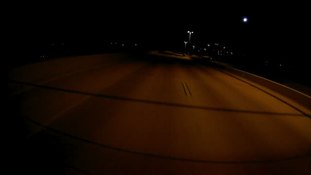 Dashboard camera point of view of driving at night
