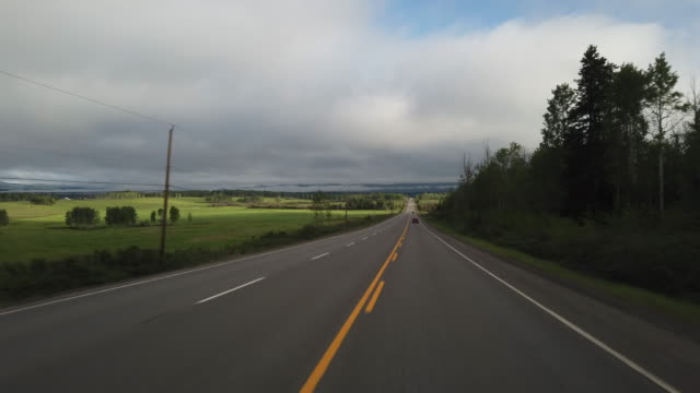 dashboard camera point of view of driving in alaska - north america stock videos & royalty-free footage