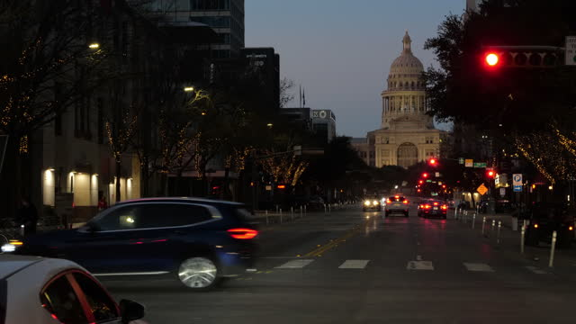 dashboard camera point of view of driving in austin at twilight. - local landmark stock videos & royalty-free footage