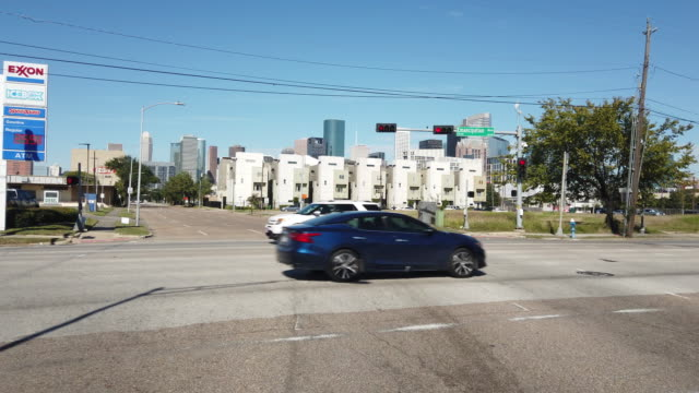 dashboard camera point of view of driving in houston - exxon stock videos & royalty-free footage