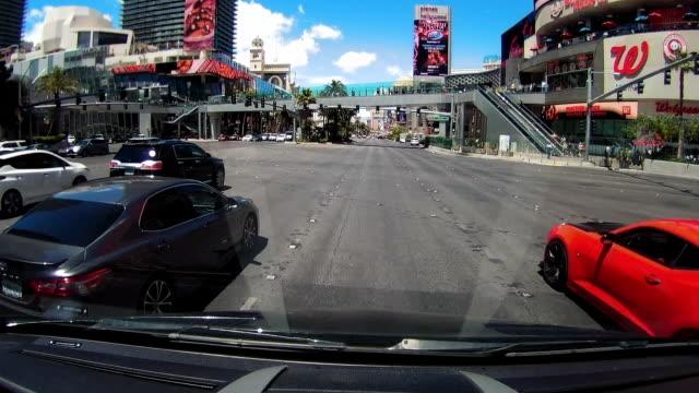dashboard camera point of view of driving in las vegas - replica della torre eiffel di las vegas video stock e b–roll