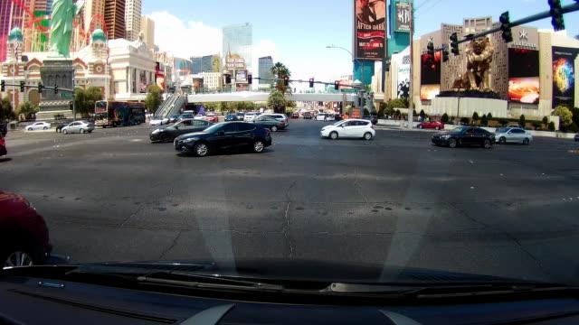 dashboard camera point of view of driving in las vegas - las vegas crosses stock-videos und b-roll-filmmaterial