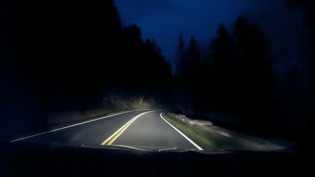 dashboard camera point of view of driving on mountain road at night - mountain road stock videos & royalty-free footage