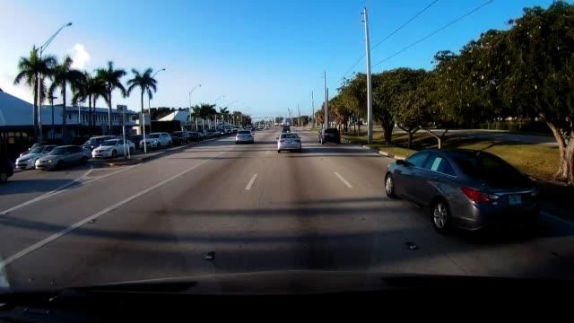 dashboard camera point of view of driving passing honda car dealerships in miami - honda bildbanksvideor och videomaterial från bakom kulisserna