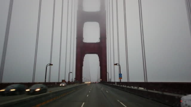 dashboard camera point of view of driving through golden gate bridge in a foggy day - golden gate bridge stock videos & royalty-free footage