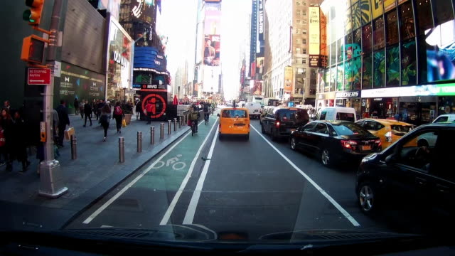 dashboard camera point of view of driving through times square - urban road stock videos & royalty-free footage