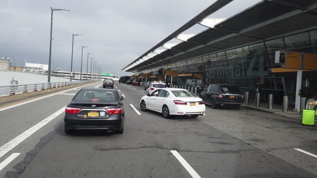 dashboard camera point of view of driving to jfk international airport amid the 2020 global coronavirus pandemic. - john f kennedy airport stock videos & royalty-free footage