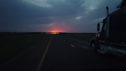 dashboard camera point of view of highway driving at sunset - truck stock videos & royalty-free footage