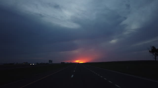 dashboard camera point of view of highway driving at sunset - american interstate stock videos & royalty-free footage