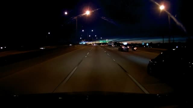 dashboard camera point of view of highway driving at twilight - dividing line stock videos & royalty-free footage
