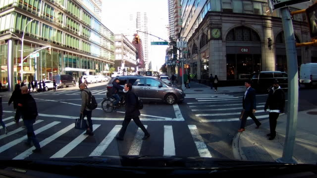 dashboard camera point of view of people crossing street in new york city - attraversare video stock e b–roll