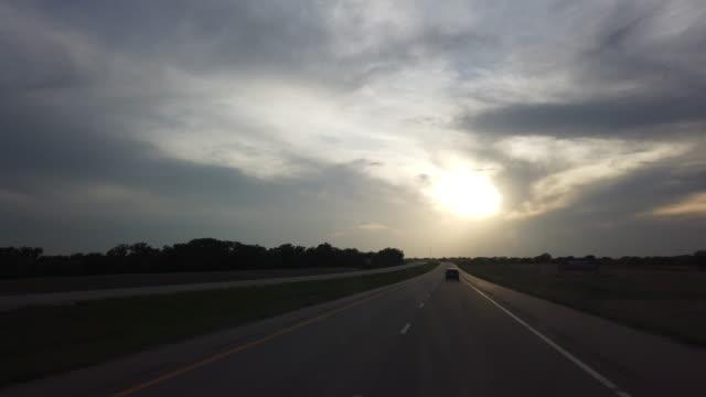 vídeos y material grabado en eventos de stock de dashboard camera point of view of single car highway driving at sunset - un solo objeto