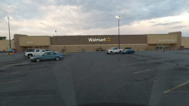 dashboard camera point of view of the parking lot at walmart super shopping center in the early morning during the 2020 global covid-19 pandemic - dramatic sky stock videos & royalty-free footage