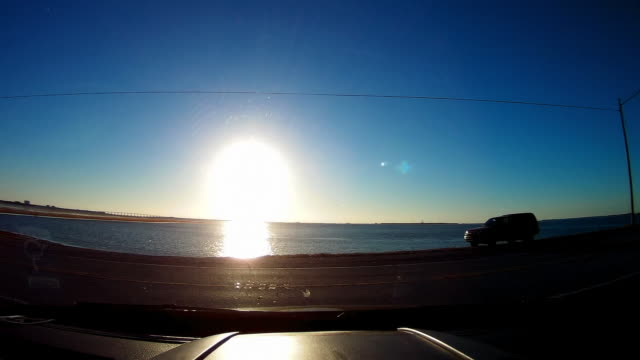 Dashboard camera point of view of through the windshield and Sun