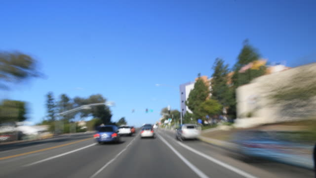 dashcam 3 hd urban streets day time - high speed photography stock videos & royalty-free footage