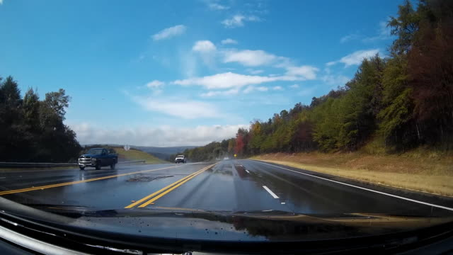 Dashcam shot of Rainy day country road driving in America