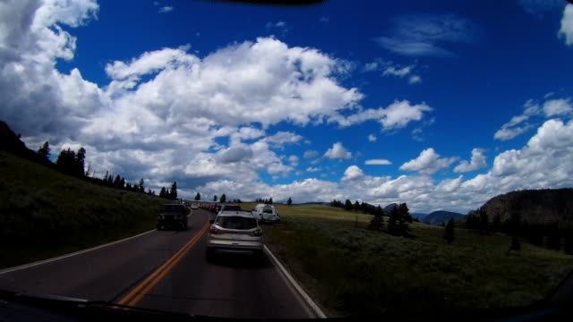 dashcam view of traffic jam on america's country road - autoperspektive stock-videos und b-roll-filmmaterial
