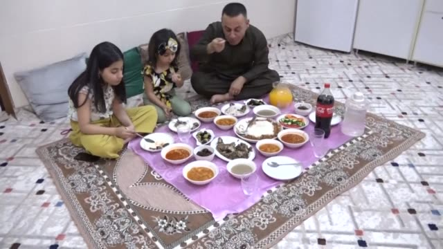 dashti abdullah an iraqi kurd is forced to have breakfast alone with his children on the first day of the eid alfitr holiday which marks the end of... - fasting activity stock videos & royalty-free footage