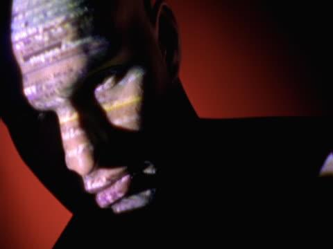 vidéos et rushes de data figures displayed on man's face - vidéo portrait