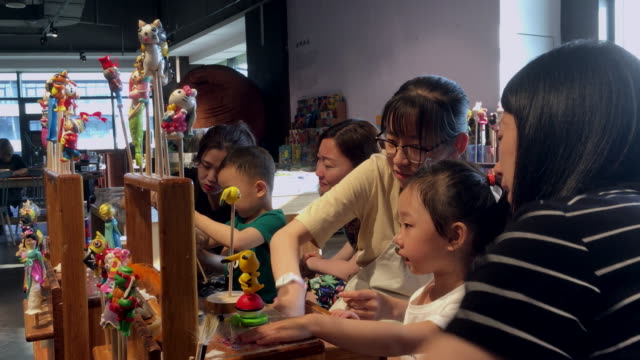 data shows chinese parents spend an average of 397 yuan for their kids on the children's day mostly on food and education - kindertag stock-videos und b-roll-filmmaterial