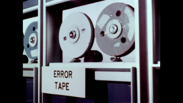 / data tapes showing 'good' and 'error' returns / error register prints out returns to be fixed / error resolution branch looks for errors finding... - punch card stock videos & royalty-free footage