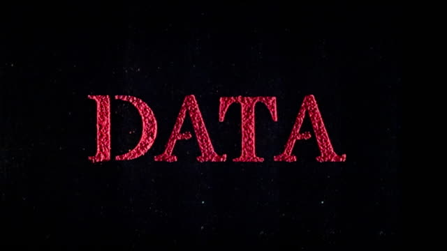 Data written in exploding text in slow motion.
