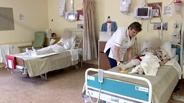 date location unknown general views elderly female patients on hospital ward - 女性患者点の映像素材/bロール