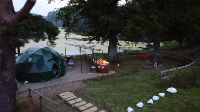 date night at a glamping site - hot tub stock videos & royalty-free footage