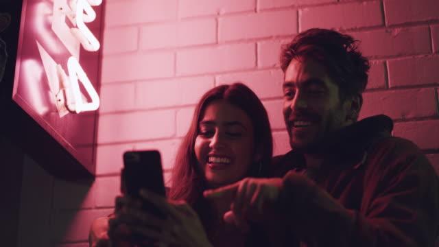 date night done right - neon video stock e b–roll
