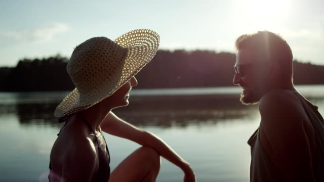 date on a lake pier. romantic landscape - pier stock videos & royalty-free footage