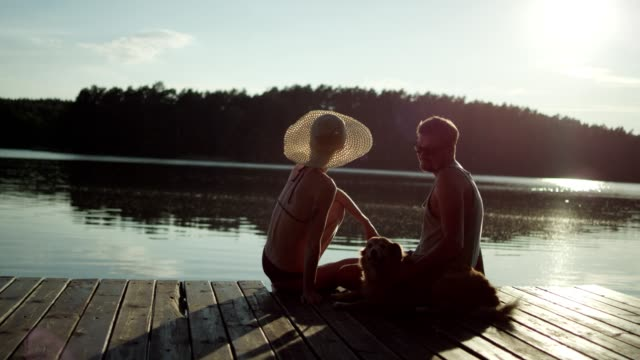 date on a lake pier. romantic landscape - pier stock videos & royalty-free footage
