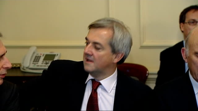 date set for chris huhne speeding trial lib / int cabinet ministers sat around table including chris huhne mp london lib / ext various shots chris... - クリス ヒューン点の映像素材/bロール
