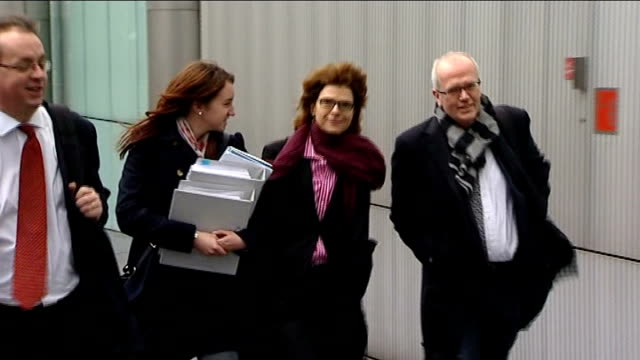 date set for chris huhne speeding trial vicky pryce leaving at court with others - ビッキー・プライス点の映像素材/bロール