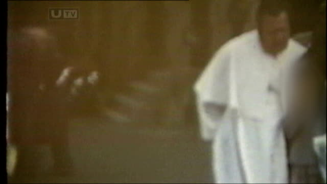 date unknown brendan smyth with his arm around a child then freeze - northern ireland stock videos & royalty-free footage