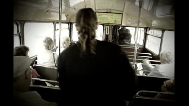 london sequence of bus conductor collecting fares on board routemaster bus and helping passenger onto bus - conductor stock videos and b-roll footage
