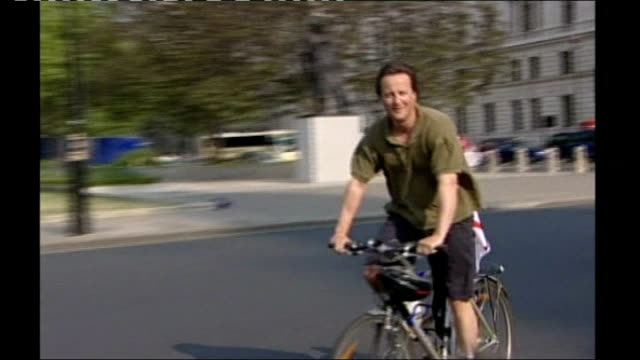 EXT Cameron cycling through parliament gates