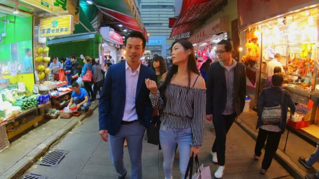 dating couple shopping in hong kong - young couple stock videos & royalty-free footage