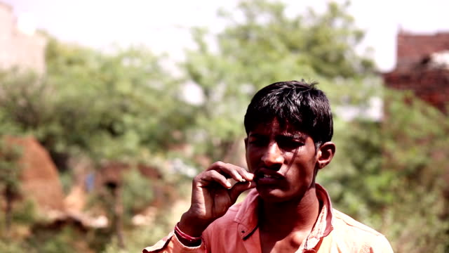 Datun or brushing teeth using plant twig