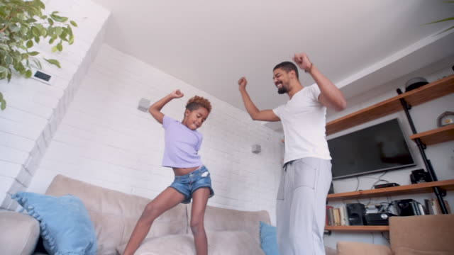 daughter and dad dancing and jumping - pre adolescent child stock videos & royalty-free footage