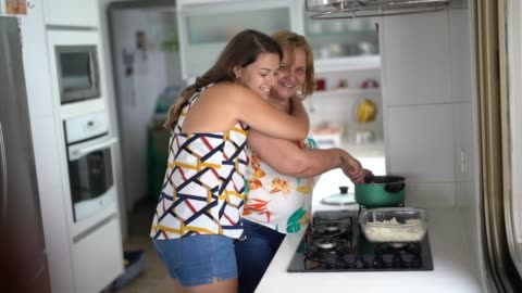 daughter and mother embracing at home - mother's day stock videos & royalty-free footage