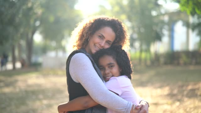 daughter and mother embracing - unity stock videos & royalty-free footage