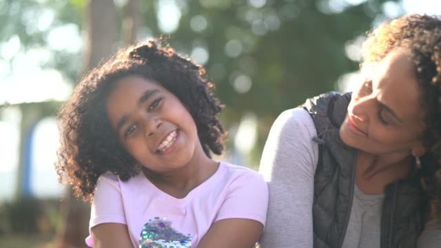 daughter and mother portrait at park - curly hair stock videos & royalty-free footage
