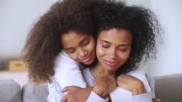 Daughter embracing mother closed eyes enjoy moment of tenderness closeup