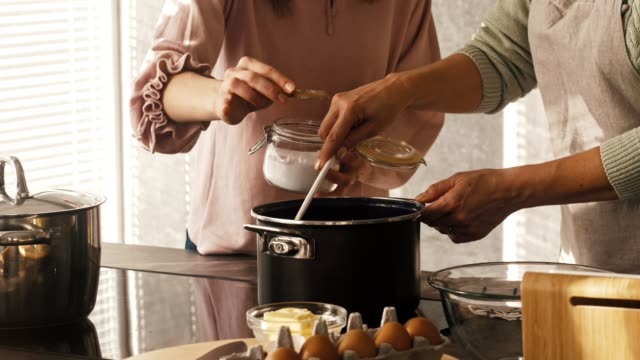 daughter helps her mother cooking - stirring stock videos & royalty-free footage