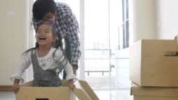 Daughter playing with her Father in our new home, Family so happy Moment