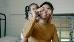 Daughter playing with her father