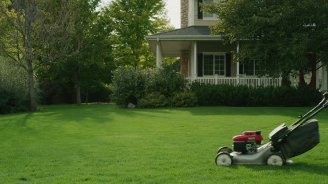daughter pushing toy lawnmower following father mowing lawn / pleasant grove, utah, united states - dotter bildbanksvideor och videomaterial från bakom kulisserna