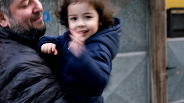 daughter running and greeting father - primary age child stock videos and b-roll footage